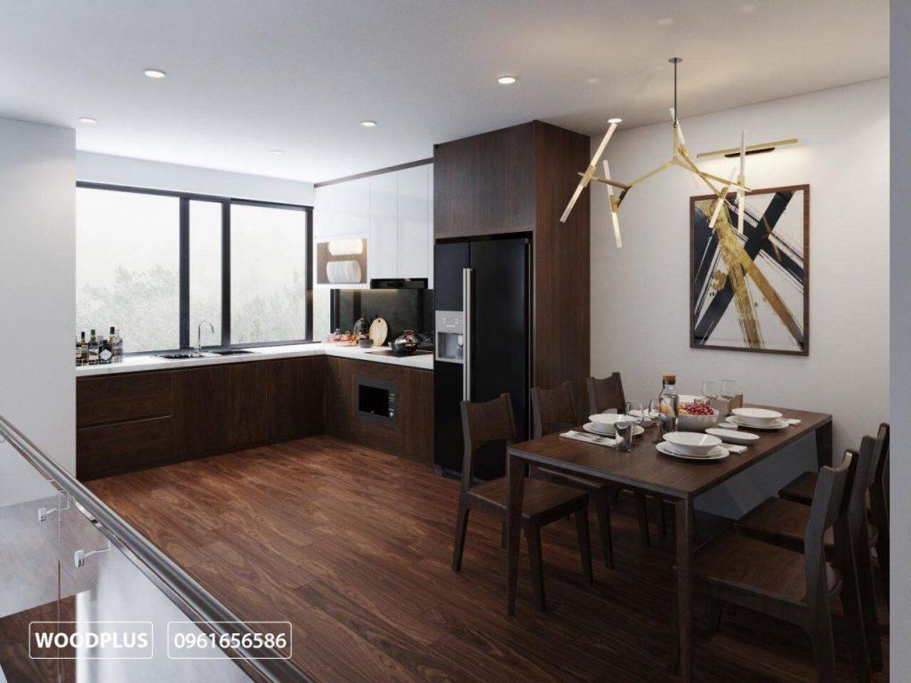 Thiết kế phòng bếp với sự liên thông giữa khu vực nấu nướng và bàn ăn tạo sự tiện lợi và linh hoạt