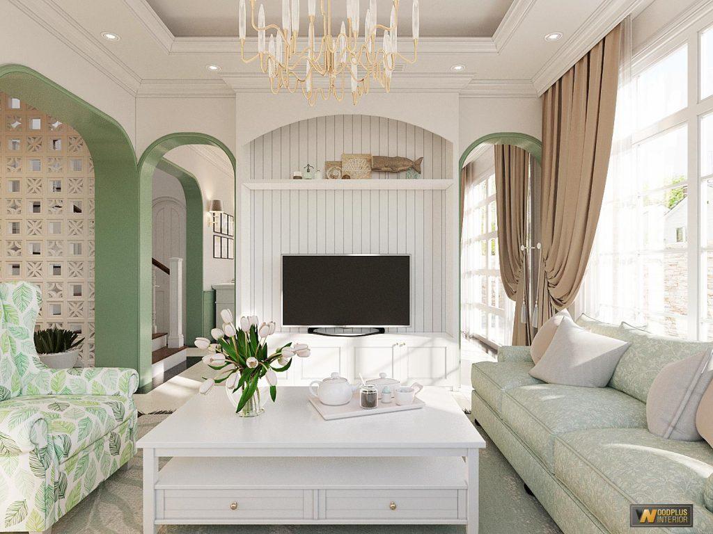 Tivi treo trên tủ tường làm hài hòa không gian phòng khách